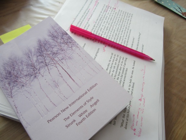 Editing my crime fiction novel. I like pink pens instead of red; they're more fun!